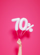 canvas print picture - 70 % sale banner white balloons and holding hand on pink. 3d rendering.