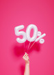 canvas print picture - 50 % sale banner white balloons and holding hand on pink. 3d rendering.