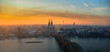 Leinwanddruck Bild - Aerial view of Cologne and Cologne Cathedral at sunset