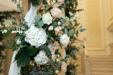 Beautiful Wedding Huppah Decorated With Fresh Fresh Flowers From Hydrangea And Eucalyptus Sheets In A Large Beautiful Wedding Hall With A Balcony. Wedding Floristry