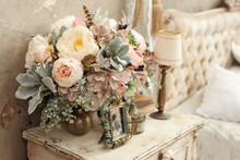 Vintage Room In A Photo Studio With A Vintage Wooden Table With Flowers And Other Elements Of Vintage Style