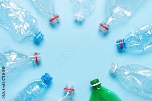 Valokuva  Plastic bottles on blue background top view