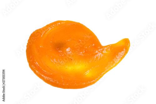 Orange sauce splashes isolated on white background