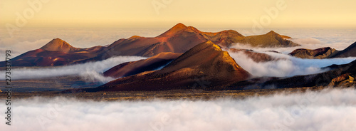 Canvas Prints Canary Islands Volcanoes in the Timanfaya national park on Lanzarote. Volcanoes rising out of the clouds