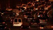Paris, France - April 6, 2019: Car Traffic by night at Paris Parc Des Princes soccer stadium taken from bridge view. Lights, cars, fires, trees, bus, blur effect. Lot of vehicles. Close up.