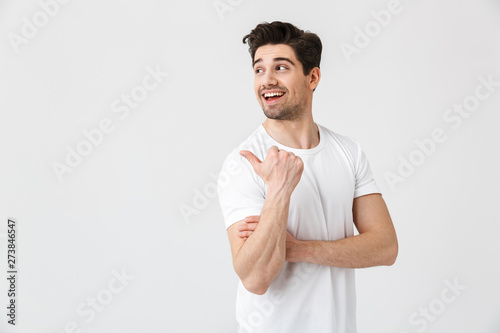 Fotografie, Obraz  Happy young excited emotional man posing isolated over white wall background