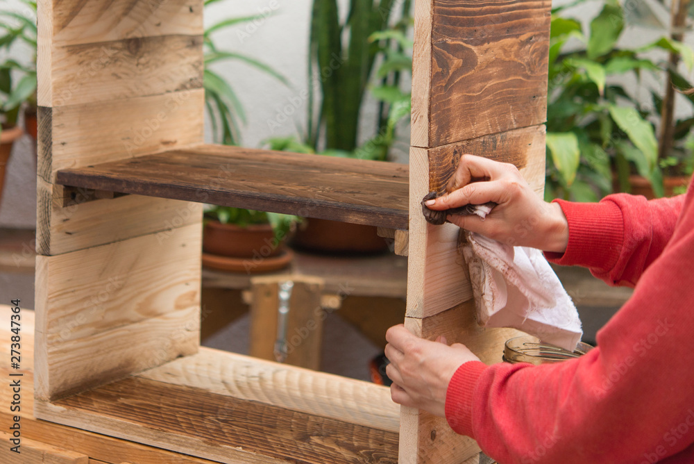 Fototapety, obrazy: woman restoring furniture Real action