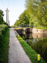 English Canal Lock And Tow Path. A Tow Path And Canal Lock On The River Lee Navigation, Near Cheshunt, North Of London.