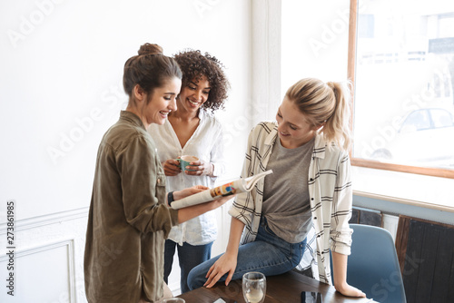 Fotografie, Obraz  Group of cheerful young women studying together