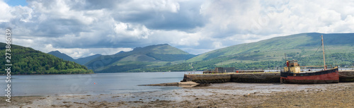 Loch Fyne with boat and pier in Inveraray, Scotland Wallpaper Mural
