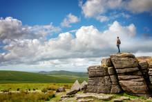 Youn Man Standing On South Hessary Tor Near Princeton In Dartmoor, Devon, UK