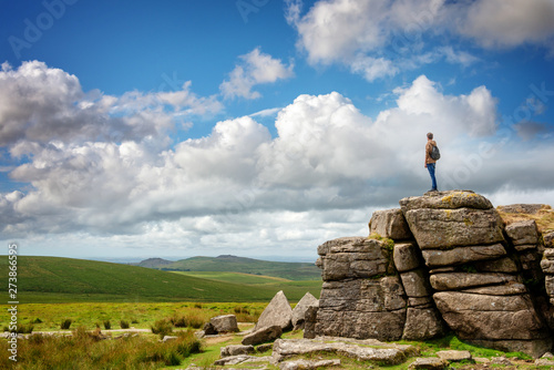 Poster Taupe Youn man standing on South Hessary Tor near Princeton in Dartmoor, Devon, UK