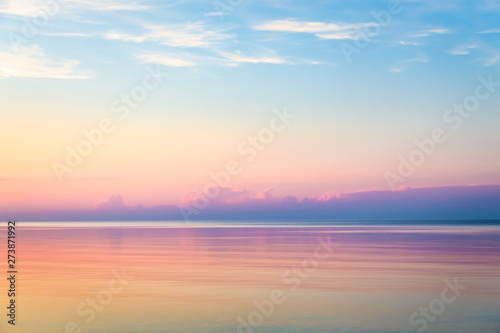 Poster Mer coucher du soleil Seascape with colorful evening sky. Natural background. Beautiful sunset over the sea in the Atlantic ocean.