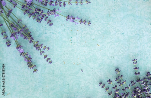 obraz lub plakat Flowers background. Frame pattern of lavender flowers on pale blue vintage background. top view. copy space