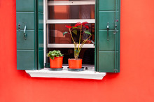 Window With Green Shutters On The Red Wall. Colorful Architecture In Burano Island, Venice, Italy.