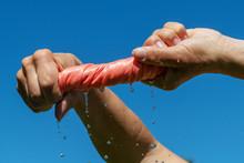 Hands Squeze Pink Wet Cloth.