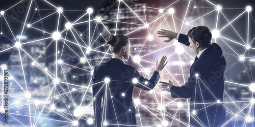 Concept of social connection and networking against night city view and partners Canvas Print