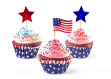 American Themed Cupcakes With Sprinkles And Decorations On A White Background