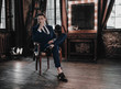 canvas print picture - Full suit young handsome businessman sitting in luxury interior. Fashion man model elegant. Stylish. Business concept. Success lifestyle