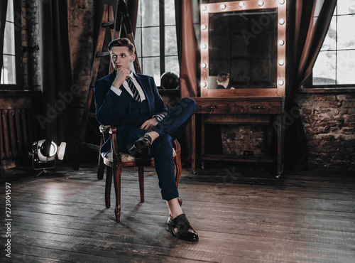 Full suit young handsome businessman sitting in luxury interior Tableau sur Toile