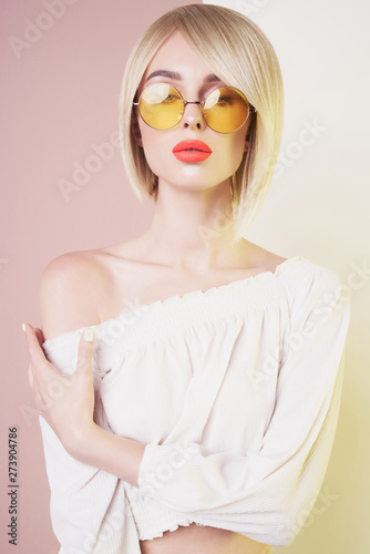 Poster womenART Sensual stylish woman in erotic white dress. Blue-eyed lady with perfect lips in modern colour sunglasses