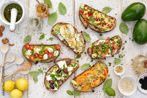 Cuadros en Lienzo Assorted  open faced sandwiches, Open avocado sandwiches made of  slices of sour
