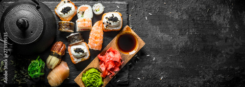 Printed kitchen splashbacks Sushi bar Traditional Japanese sushi rolls with green tea.