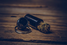 Storing Cannabis Cones In A Keychain Container In The Form Of A Bullet Close-up. Carrying And Storing Legalized Soft Drug In Pocket Crisper
