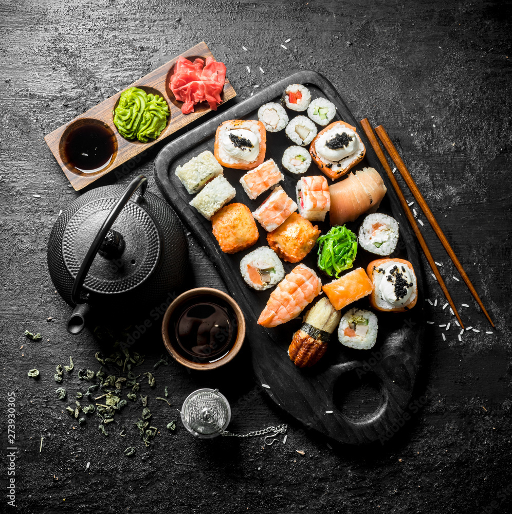 Fototapety, obrazy: Sushi, rolls and maki with soy sauce, ginger and green tea.