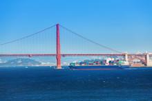 Cargo Ship Passing Under Golden Gate Bridge, USA