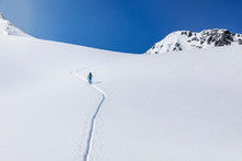 Austria, Tyrol, Between Ischgl And Galtuer, Hohe Koepfe, Ski Tourer Climbing Up To The Summit In Winter
