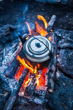 Boiling Water Pot Over An Open Fire On A Campsite On Tolbachik Volcano, Kamchatka, Russia