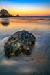 canvas print picture Rocks on Beach at Sunset, Sunrise