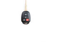 A Toyota Car Key Is Isolated On A White Background.