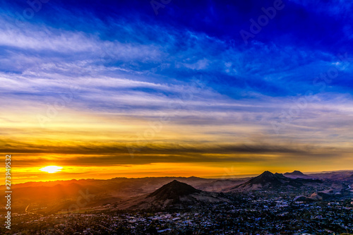 Orange Sunset over City and Mountains