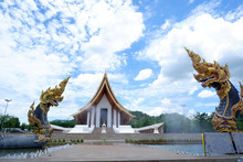Two Naga Statue,King Of Nagas Serpent Animal In Buddhist Legend And Blue Sky Clouds In Background At Wat Dhammayan,Thailand