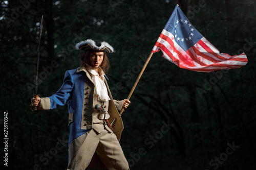 Photo  Soldier patriot rebel during war of independence of  United States with flag pre