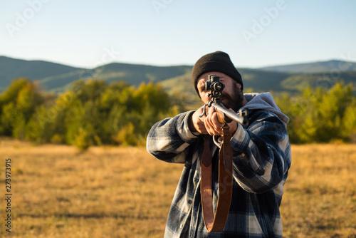 Photo  Hunter with shotgun gun on hunt