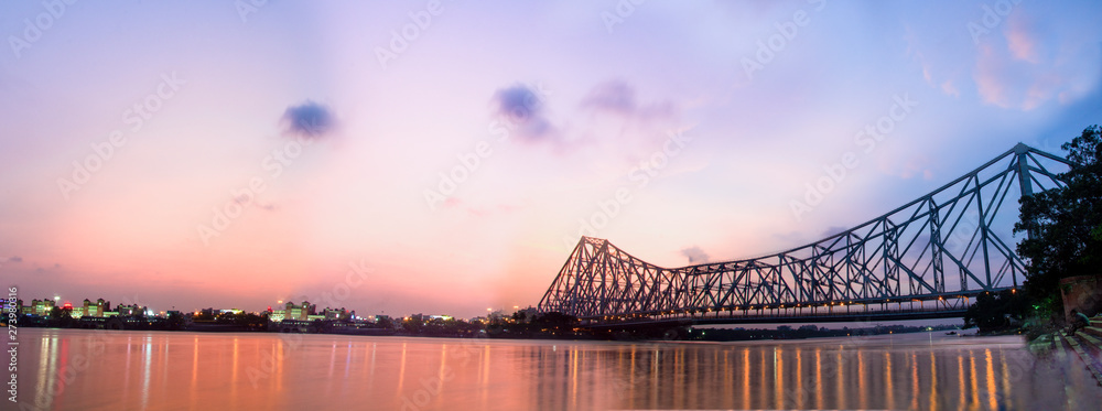Panorama of Howrah bridge on river Ganges in kolkata city , India
