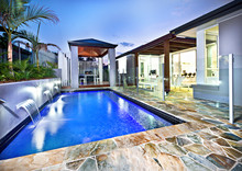 Modern Swimming Pool Side With Glass Cover At Night