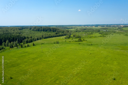 Obraz na płótnie Aerial view on the countryside and the agricultural field