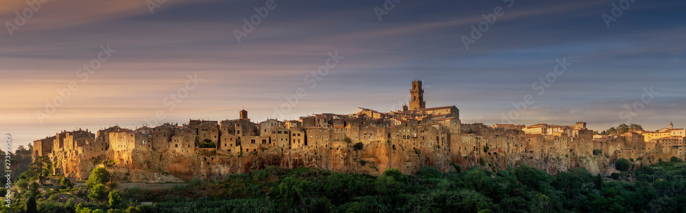 PITIGLIANO, TUSCANY, ITALY - JUNE 15, 2019 - View of Pitigliano town at sunset. Picturesque and unusual - built on tuff, tufaceous volcanic rock.