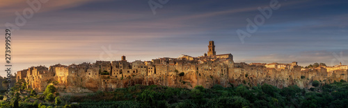 PITIGLIANO, TUSCANY, ITALY - JUNE 15, 2019 - View of Pitigliano town at sunset. Picturesque and unusual - built on tuff, tufaceous volcanic rock. - 273999529