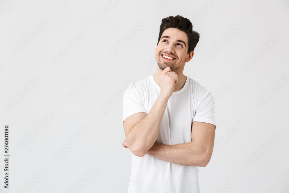 Fototapeta Happy young excited emotional man posing isolated over white wall background.