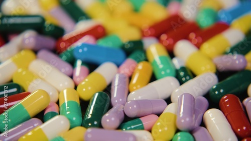 Fotomural Pharmaceutical drug, a bunch of multi-colored round capsules of tablets with antibiotic medicine in packages