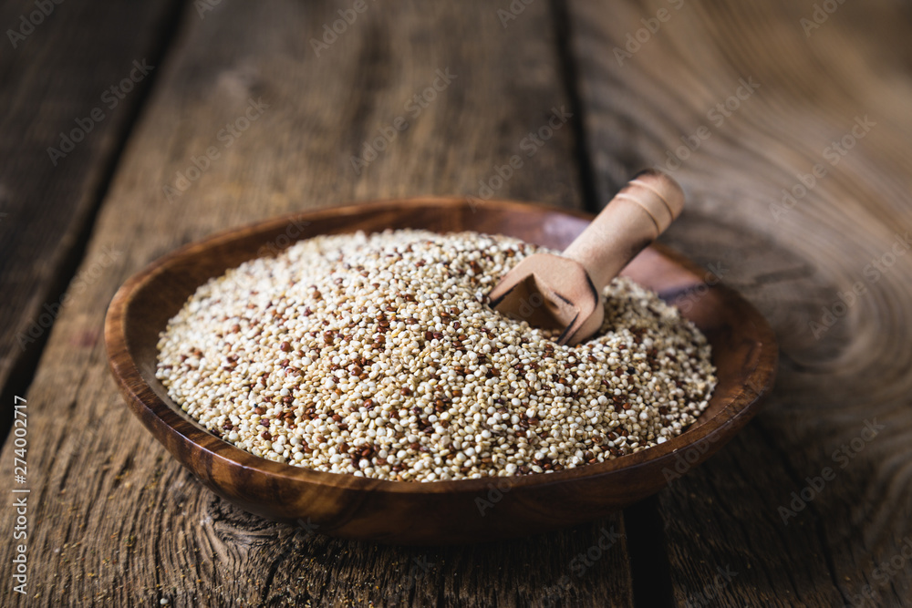 Fototapety, obrazy: Quinoa seeds on a wooden table