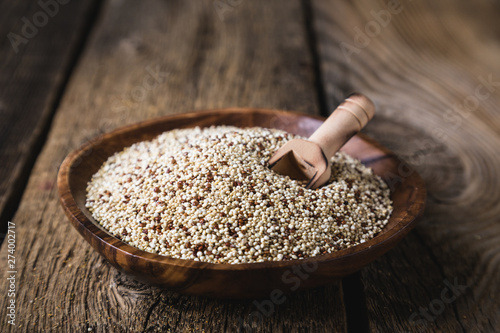 Quinoa seeds on a wooden table Canvas-taulu