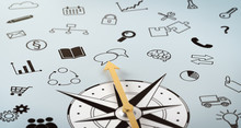 A Compass With Scribbled Icons
