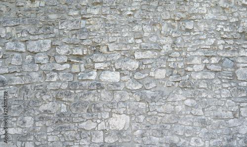 Fototapeta Sehr alte Steinmauer aus vielen grauen groben Natursteinen obraz
