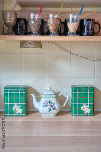 Details on a shelf in a kitchen with a teapot and mugs Canvas Print